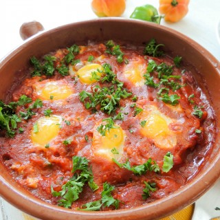Poached quail eggs in tomatoes sauce